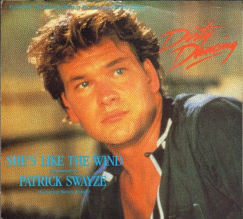 Swayze, Patrick - She's Like The Wind (from film -Dirty Dancing)/Stay (by Maurice Williams & The Zodiacs on flip-side) (with picture sleeve) - NM9/EX8 - 45 rpm Records